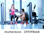 gym woman exercising with her... | Shutterstock . vector #259398668