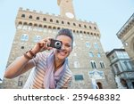 happy young woman taking photo... | Shutterstock . vector #259468382