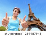 Stock photo happy travel woman in paris with eiffel tower and she show thumb up asian beauty 259487945