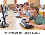 cute pupils in computer class... | Shutterstock . vector #259616018