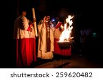 Small photo of KUALA LUMPUR, April 19, 2014: Catholics celebrated Easter eve mid-night mass at Church of St. Thomas More in Malaysia. The priest lighted up the new fire on the Paschal Candle as part of the ritual.