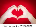 Hands Heart Isolated On Red...