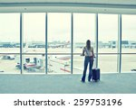 girl at the airport window | Shutterstock . vector #259753196