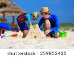 Father And Son Building Sand...