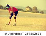 Young Woman Runner Taking A...
