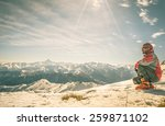 Small photo of Alpinist on the mountain summit. Shot in backlight, stunning panoramic view of the alpine arc. Concept of success and conquering the top. Toned image, old retro touch.