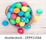 easter eggs on wooden...   Shutterstock . vector #259911566
