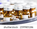 close up amber color vials with ... | Shutterstock . vector #259985186