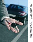 man in suit offering a car key... | Shutterstock . vector #260000546