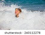 happy little girl wearing swim... | Shutterstock . vector #260112278
