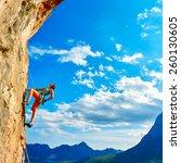 female rock climber climbs on a ... | Shutterstock . vector #260130605