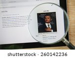 Small photo of CHIANGMAI, THAILAND - February 26, 2015: Photo of Wikipedia article page about Warren Buffett on a ipad monitor screen through a magnifying glass.