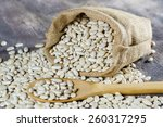 Sack With White Beans On Woode...