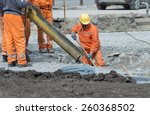 Worker Leveling Concrete Poure...