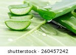 Small photo of Aloe sliced on a green background