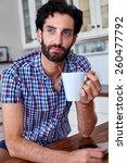 content man enjoying coffee at... | Shutterstock . vector #260477792