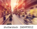 Small photo of Abstract background - people shopping, walking and riding bikes in main shopping street in Palermo, Italy - radial zoom blur effect defocusing filter applied, with vintage instagram look.