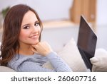 happy pretty woman using laptop ...   Shutterstock . vector #260607716