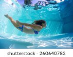 Young Lady Swimming Underwater...
