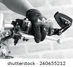 human hand in a motorcycle... | Shutterstock . vector #260655212