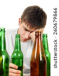 Small photo of Sad and Depressed Young Man in Alcohol addiction on the White Background