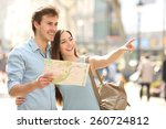 couple of tourists consulting a ... | Shutterstock . vector #260724812