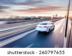 Stock photo car driving on freeway at sunset motion blur 260797655