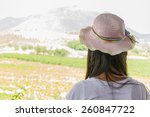 Small photo of Young woman in summer looking aimlessly at vineyard ,Thailand.