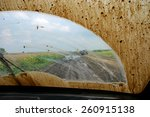 of road driving through the mud ... | Shutterstock . vector #260915138