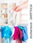 hand holding dirty white socks...   Shutterstock . vector #260973116