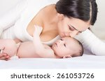 happy family. mother and baby | Shutterstock . vector #261053726