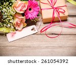 bunch of flowers with gift box... | Shutterstock . vector #261054392