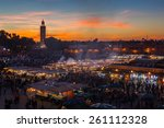 Small photo of MARRAKESH, MOROCCO - DECEMBER 27: Crowd in Jemaa el Fna square at sunset on December 27, 2014 in Marrakesh, Morocco. Blur of moving objects and people to imply movement.