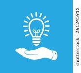 flat hand giving light lamp... | Shutterstock . vector #261245912