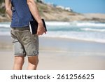man holding notebook while... | Shutterstock . vector #261256625