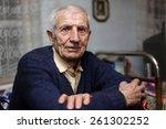 Portrait Of  Sitting Senior Ma...