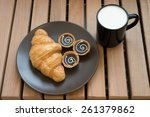 croissant and milk. | Shutterstock . vector #261379862