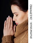 portrait of a woman praying to... | Shutterstock . vector #261394982