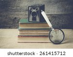 books  camera  and magnifying... | Shutterstock . vector #261415712