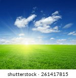 green field blue sky and sun.  | Shutterstock . vector #261417815