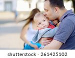 young father kissing his son. 1 ... | Shutterstock . vector #261425102