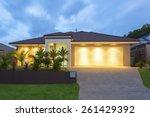 well lit modern home exterior... | Shutterstock . vector #261429392