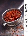 saffron on a metal scoop | Shutterstock . vector #261466772