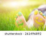 child lying on green grass. kid ... | Shutterstock . vector #261496892