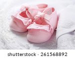 pink baby boots on cloth close... | Shutterstock . vector #261568892