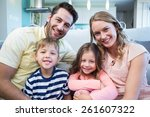 happy family smiling at camera... | Shutterstock . vector #261607322
