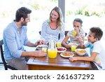 happy family having breakfast... | Shutterstock . vector #261637292