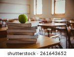 apple on pile of books at the... | Shutterstock . vector #261643652