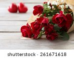 Red Roses Wrapped In Paper With ...