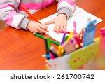 little girl draws sitting at... | Shutterstock . vector #261700742